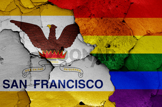 flags of San Francisco and LGBT painted on cracked wall