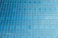 Glass facade modern office building in Dutch city Utrecht