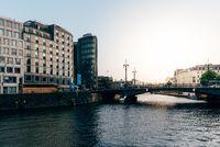 Bridge on Spree river in Berlin. Sun flare on background