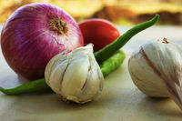 Basic ingredients for Indian curries, onion, garlic, tomato and chilly