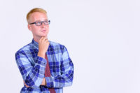 Portrait of young blonde businessman with eyeglasses thinking