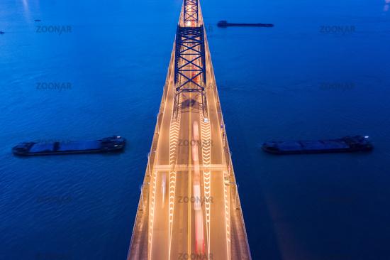 bridge on river closeup in nightfall