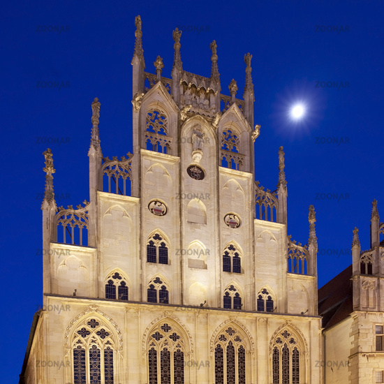 town hall on historic principal marketplace with moon in the evening, Muenster, Germany, Europe