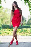 Lovely girl posing standing outdoors.