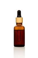 Essentail oil in glass dropper.