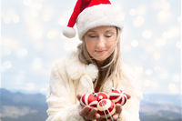 Woman holding Christmas baubles - Christmas in Blue Mountains