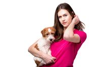 Pretty girl with terrier puppy. Studio image