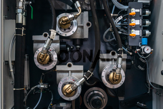 Hoses on Industrial Machine Fluid Transporting Coupling Metal Detail Manufacturing Cooling Generic Closeup