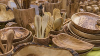 Kitchen wooden utensils for cooks. spoons, mallets, forks and cutlery handmade in handcrafted wood