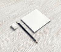 Notebook, pencil and eraser