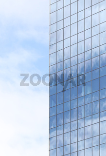 Sky reflecting in windows of office building