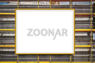blank advertisement billboard on scaffolding / building facade -