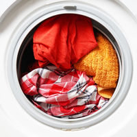 washing machine or washer full of colored washables
