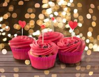 close up of cupcakes with heart cocktail sticks
