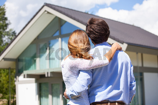 Couple and their house