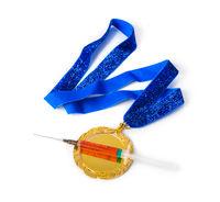 Gold medal and syringe
