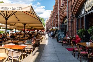 People enjoying in restaurant terraces in Berlin