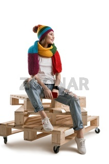 Pretty teenager in knitted hat isolated shot