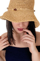 Mysterious woman with big straw hat in close up