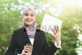 Muslim business woman going to work