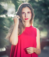 Fashion portrait of a beautiful woman in red dress