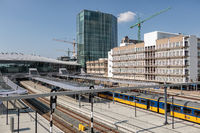 Railway station Utrecht with waiting trains and travelers