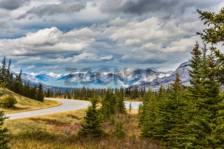 The road to snow-capped mountains