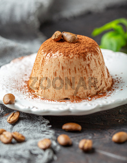 Coffee Panna cotta sprinkled with cocoa powder.