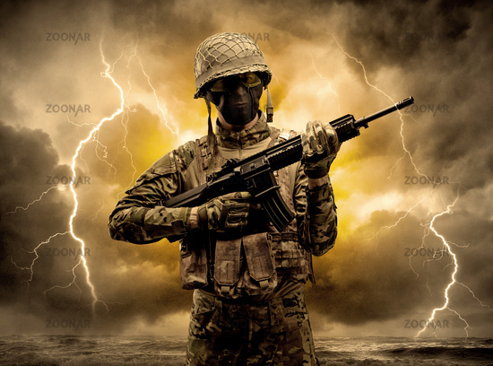 Armed soldier standing in an obscure weather
