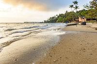 Beach on brazilian Ilhabela tropical island at sunset