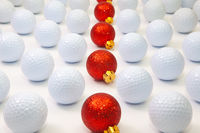 Pattern with white golf balls and red Christmas decoration