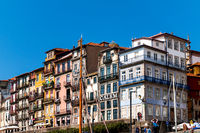 Historic house facades in the old center of Porto on the banks of the Douro River