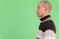 Profile view of handsome bald multi ethnic man ready for winter