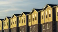 Panorama frame Townhouses on a neighborhood under blue sky and clouds on a sunny day