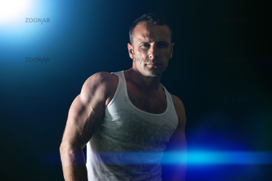 handsome muscle man blue light