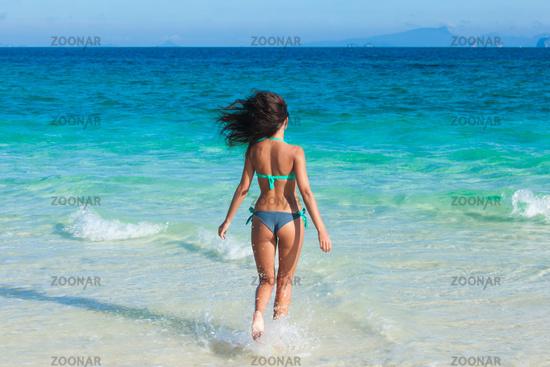 Woman run to sea