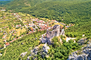 Town of Vrlika and Prozor hill fortress ruins aerial view