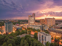 Munich from above, a panoramic droneshot in the colorful evening.