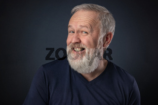 Old man pretending to laugh