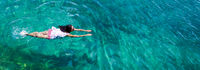 Aerial view of a woman in the sea