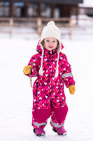 little girl having fun at snowy winter day
