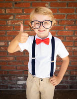 Cute Young Caucasian Boy With Thumbs Up Wearing Glasses and Red, White and Blue