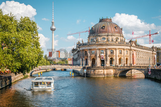 Museum Island, boat on river spree and Tv Tower during summer day in Berlin, Mitte