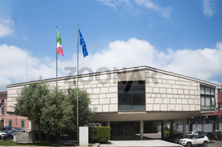 View of Carrara, Italy: the town hall building of the Tuscan city Carrara with the Italian and European flag
