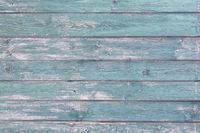 Holzdielen mit abgeblätterter Farbe als Hintergrund