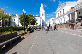 Large plaza park and metropolitan cathedral Quito in a sunny day