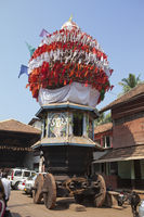 GOKARNA, INDIA - JANUARY 31, 2014: The ancient  wooden chariots with flags and paintings of hindu go