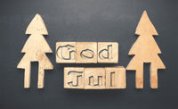 Wooden tree shapes and blocks with God Jul
