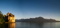 Montreux, VD / Switzerland - 31 May 2019: panorama view of Lake Geneva and the historic Chillon Castle on the lakeshore near Montreux