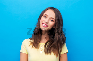 young woman or teenage girl in yellow t-shirt